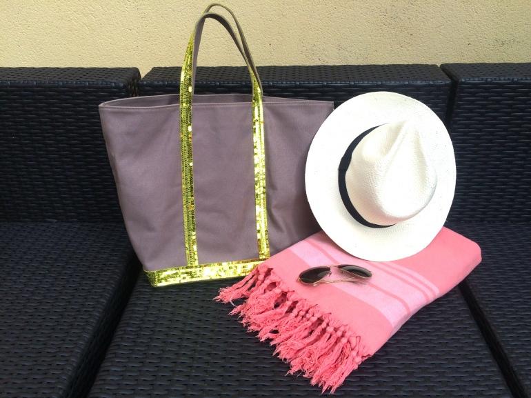 what's in my beach bag essentials chapeau fouta sac vanessa bruno